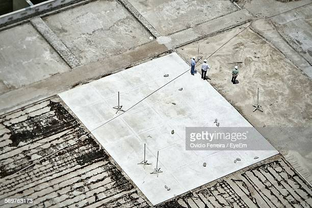 Aerial View Of Construction Workers Standing At Construction Site