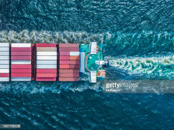 aerial view of  container ship in sea - ferry stock photos and pictures