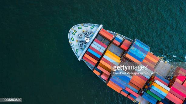 aerial view of container ship in sea - cargo ship stock pictures, royalty-free photos & images