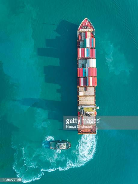 aerial view of container ship runing on sea to transport. - shipyard stock pictures, royalty-free photos & images