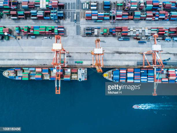 aerial view of containers and container ship in sea - cargo container stock pictures, royalty-free photos & images