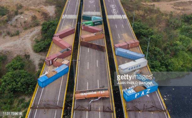 TOPSHOT Aerial view of containers blocking the Tienditas Bridge which links Tachira Venezuela and Cucuta Colombia as seen from Cucuta Colombia on...