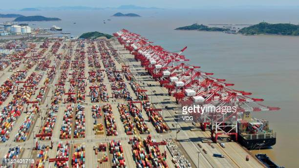 Aerial view of containers sitting stacked among gantry cranes at Yangshan Deep Water Port on May 28 2019 in Zhoushan Zhejiang Province of China