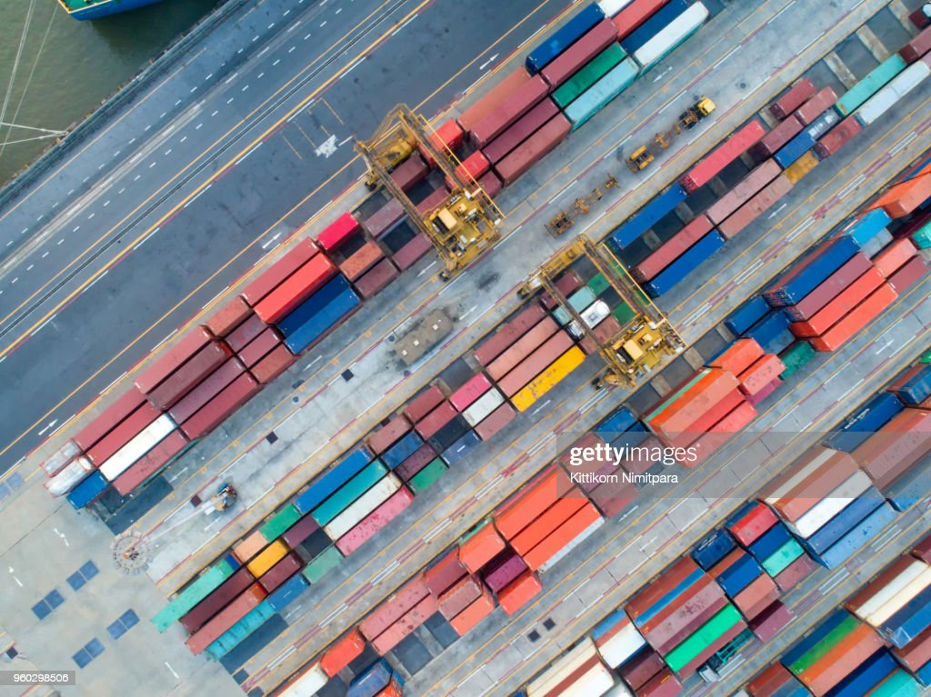 aerial view of containers yard in port congestion with ship vessels