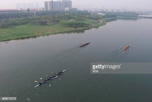 Aerial view of contestants rowing on the Longzi Lake during the 2016 Deep Dive Rowing Friendly Match at Zhengdong New District on September 15, 2016...