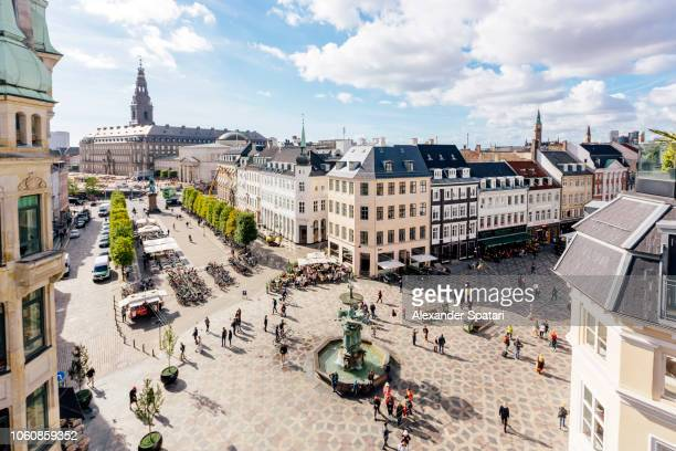 aerial view of copenhagen skyline and amagertorv town square with fountain, denmark - stadsplein stockfoto's en -beelden