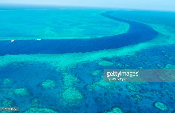 Aerial view of coral banks reef systems and the pacific ocean on November 20 2015 in Great Barrier Reef Australia