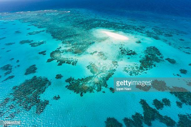 Aerial view of coral cay and Great Barrier Reef