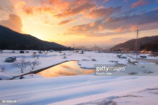 Aerial view of countryside of Yamanouchi town with snow covered on rice field in winter, Nagano, Japan.