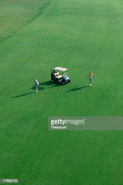 Aerial view of couple and golf cart