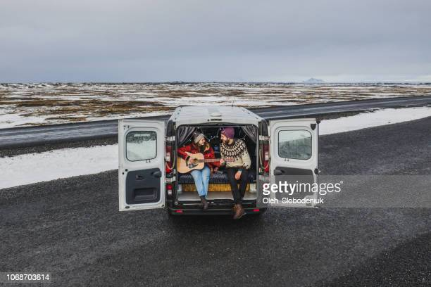 aerial view of couple in camper van in iceland - musical equipment stock pictures, royalty-free photos & images