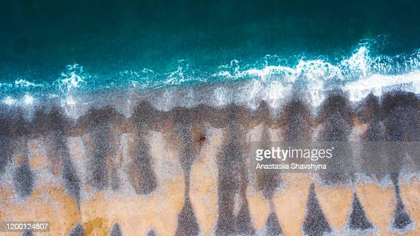 aerial view of couple staying at the colorful beach in france - sarthe stock pictures, royalty-free photos & images