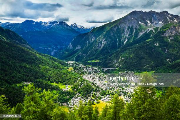 Aerial view of Courmayeur city surrounded by mountains