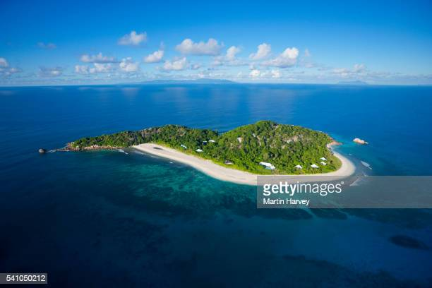aerial view of cousine island.seychelles - island stock pictures, royalty-free photos & images