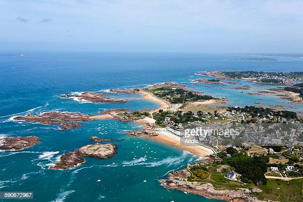 Aerial view of Cozpors beach and the Forum de Tregastel pool complex in Brittany the cote de granit rose on the northern Breton coast