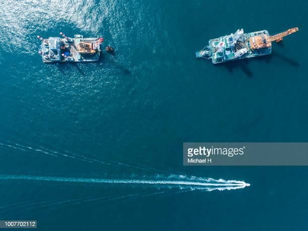 Aerial view of crane ships in sea