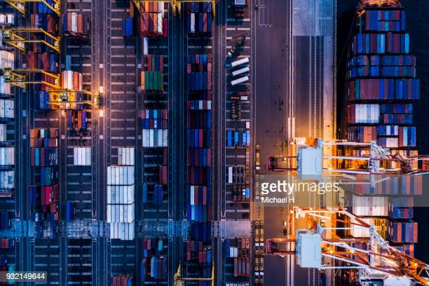 aerial view of cranes and containers in  port. - porto marittimo foto e immagini stock