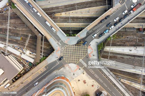 aerial view of crossroads above railway tracks, birmingham, england, uk - birmingham england stock pictures, royalty-free photos & images