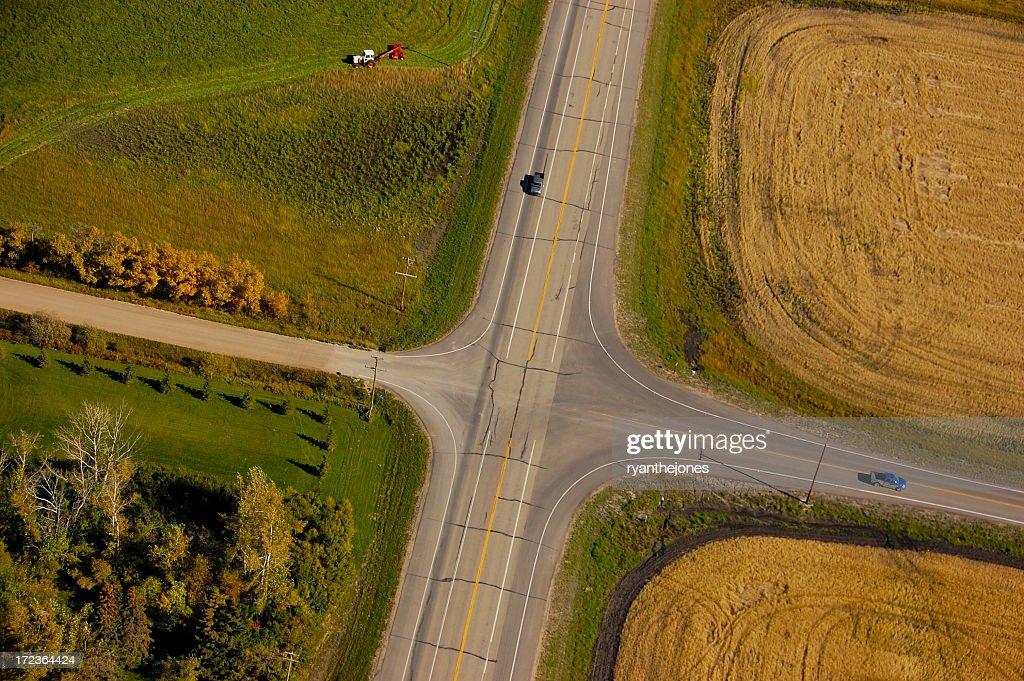 Aerial view of crossroads between rural land : Stock Photo
