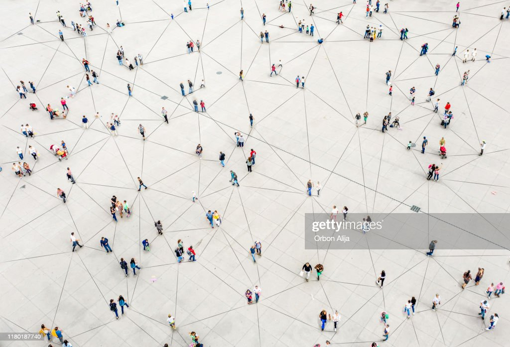 Aerial view of crowd connected by lines : Foto stock