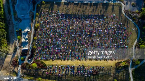 Aerial View Of Crowd Doing Yoga On Ground