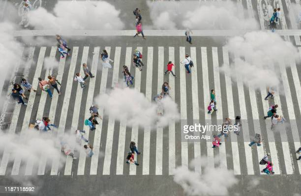 aerial view of crowd with clowds - cloud computing stock pictures, royalty-free photos & images