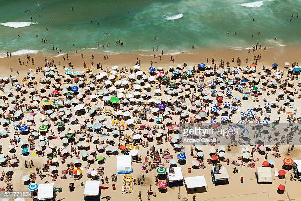 aerial view of crowded beach of ipanema, rio de janeiro, brazil - crowded beach stock pictures, royalty-free photos & images