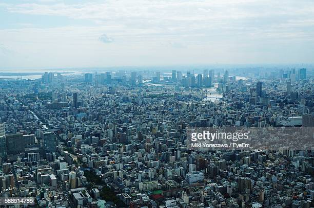 Aerial View Of Crowded Cityscape Against Sky