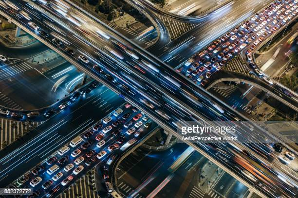 aerial view of crowded traffic at night - traffico foto e immagini stock