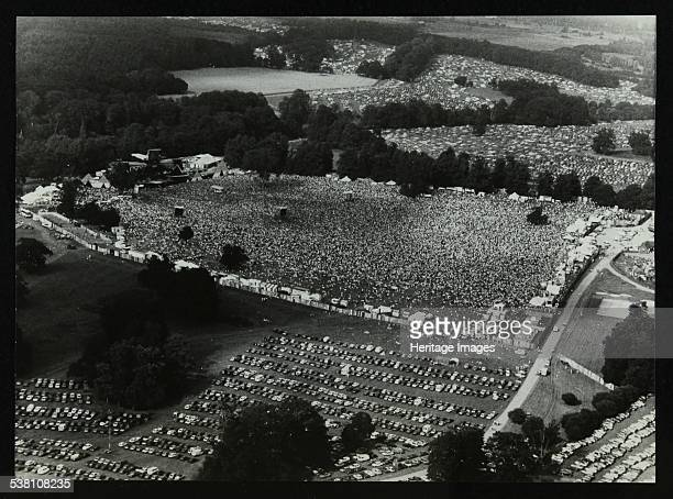 Aerial view of crowds at the Knebworth pop festival, 1986. Artist: Denis Williams.
