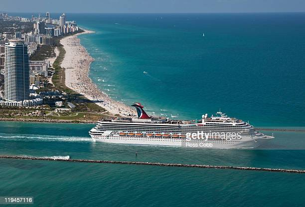 Aerial view of cruise ship leaving port via Government Cut in Miami, FL.