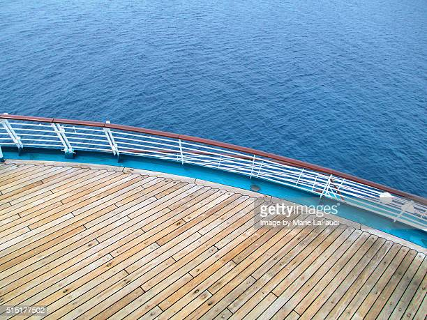 Aerial view of cruise ship stern with deck & railing