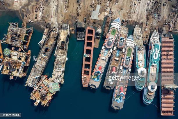 aerial view of cruise ships being broken down for scrap - nautical vessel stock pictures, royalty-free photos & images