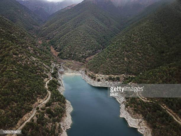 aerial view of dam in forest. - trabzon stock pictures, royalty-free photos & images