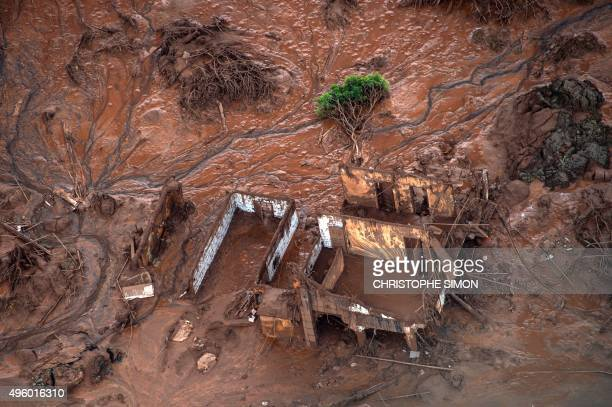 Aerial view of damages after a dam burst in the village of Bento Rodrigues in Mariana Minas Gerais state Brazil on November 6 2015 A dam burst at a...