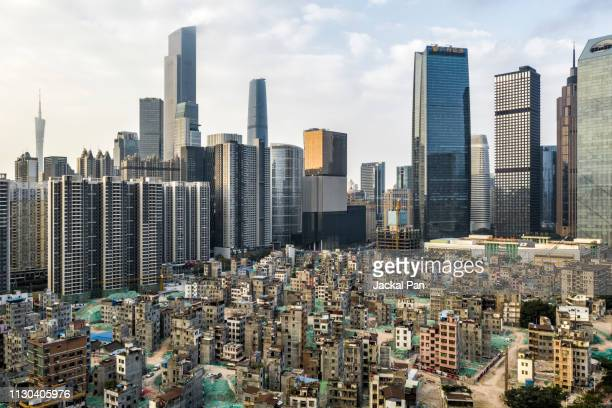 aerial view of demolishing urban village against modern residential areas - slum stock pictures, royalty-free photos & images