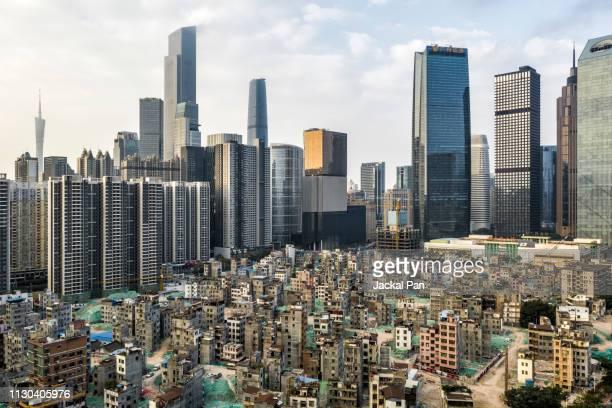 aerial view of demolishing urban village against modern residential areas - província de guangdong - fotografias e filmes do acervo