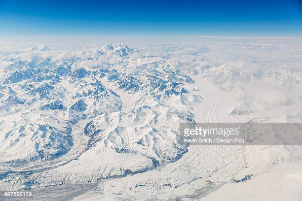 Aerial view of Denali and Mt. Foraker covered in snow with the Buckskin Glacier running into the foreground, Interior Alaska, USA, Winter
