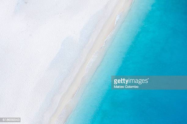 aerial view of deserted sandy beach. greece - water's edge stock pictures, royalty-free photos & images