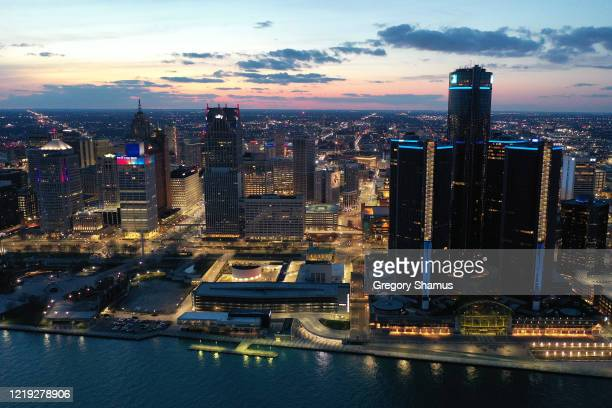 Aerial view of Detroit on April 16, 2020 in Detroit, Michigan. Landmarks and buildings across the nation are displaying blue lights to show support...