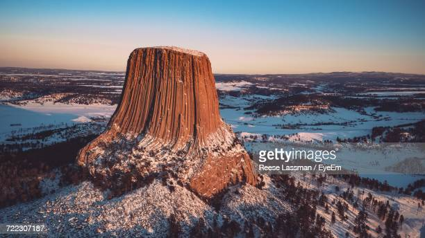 Aerial View Of Devils Tower National Monument Against Sky During Sunset In Winter