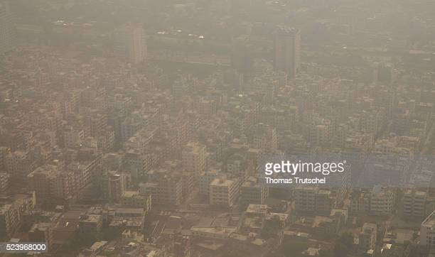 Aerial view of Dhaka from an aircraft on residential buildings under a layer of smog on April 10 2016 in Dhaka Bangladesh