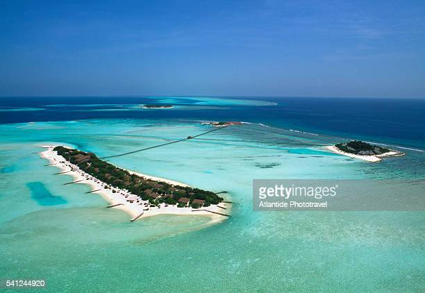 aerial view of dhigufinolhu and veligandu hura - male maldives stock pictures, royalty-free photos & images
