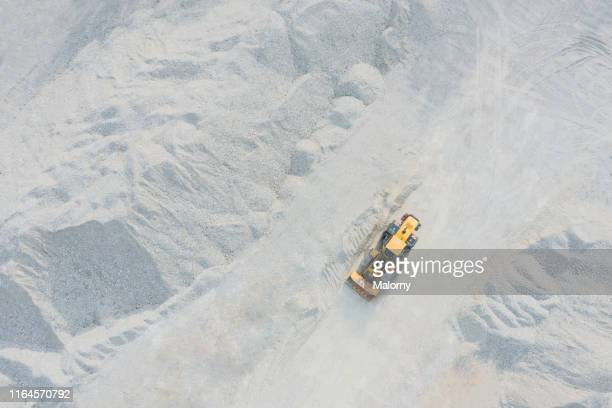 aerial view of digger at quarry. drone view. - 石切場 ストックフォトと画像