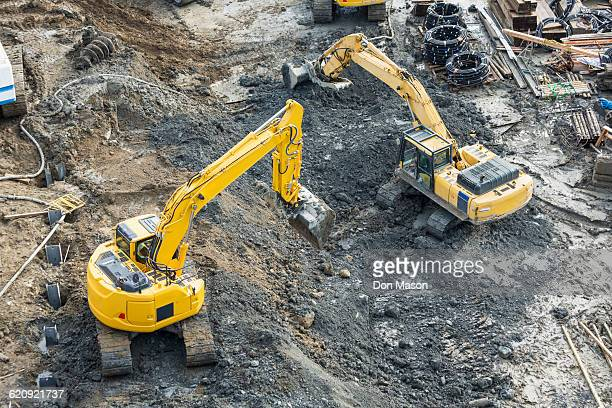 Aerial view of diggers at construction site