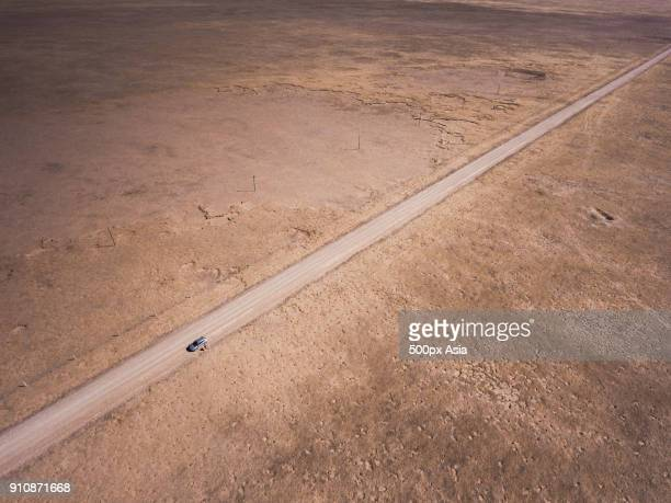 aerial view of dirt road in desert, golog, qinghai province, china - image stock pictures, royalty-free photos & images