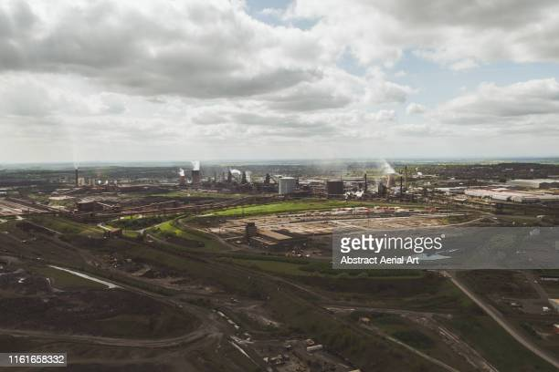 aerial view of distant power plant, scunthorpe, united kingdom - north lincolnshire stock pictures, royalty-free photos & images