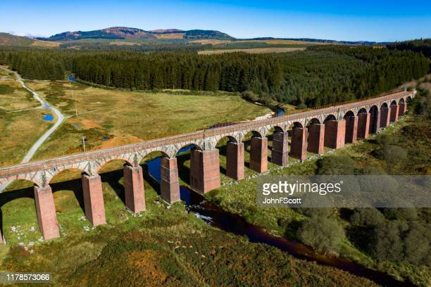 aerial view of disused railway viaduct - johnfscott stock pictures, royalty-free photos & images