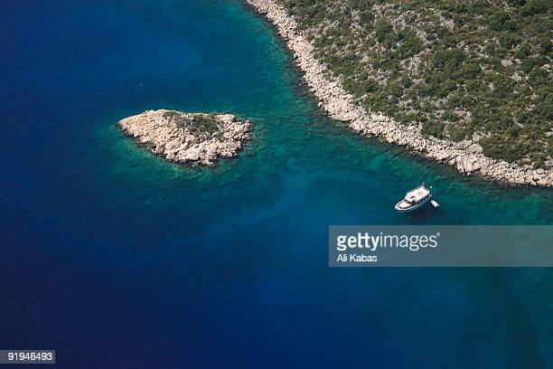 Aerial view of dive boat moored at rocky shore in Kas, Antalya, Turkey