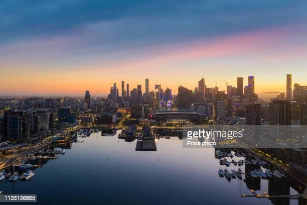 aerial view of docklands waterfront during sunrise in melbourne, victoria, australia. - docklands stadion melbourne stockfoto's en -beelden